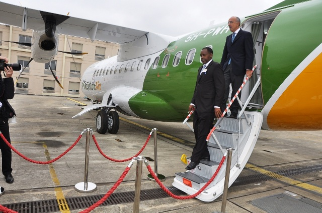 Precision Air Tanzania has become the first airline in Africa and the world to operate the ATR 42-600 commercial aircraft. The Precision Air Tanzania Chief Executive Officer Alfonse Kioko (first) and the ATR CEO Filippo Bagnato disembark from the ATR 42-400 aircraft after inspection of the plane's facilities during the official delivery of the aircraft at the ATR Delivery Center in Toulouse, France.2012.